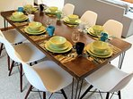 The dining table is large enough to comfortably seat 8 people.