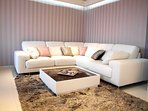 Lounge area with a large sofa, satellite TV, DVD and CD player