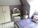 Main bedroom is light & spacious with a double bed, wardrobe , dressing table , a really pretty room