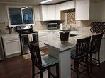 Kitchen area with all the essential utensils. Coffee and tea are complimentary