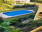 Large swimming pool with stainless steel bench seating for 18 people