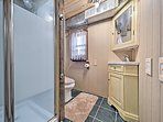 A mirrored vanity and walk-in shower highlight the bathroom.
