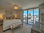 The master bedroom includes the luxury of a private balcony.