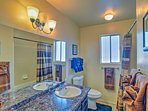 Take a hot shower after a fun-filled day in this full bathroom.