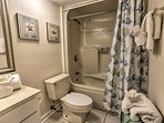 Prepare for a night on the town in this spacious bathroom.