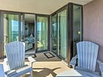The covered balcony sits steps from the master suite.