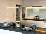 Fully equipped kitchenette and dining space