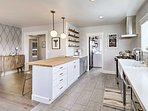 Caesar stone butcher block countertops complement the stainless appliances.