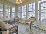 There's plenty of seating for everyone in the open and bright sunroom.