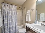 Wash up in the bathroom, equipped with a shower/tub combo.