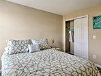 The first bedroom features a cozy queen bed.