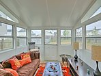 The sunroom is the perfect place to unwind at the end of the day.