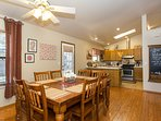 Share home-cooked meals with loved ones at the wood dining table.