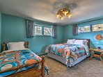This colorful bedroom sleeps 3 with a queen and twin bed.