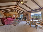 Mid-century meets log cabin in this spacious modern home with elegant decor.