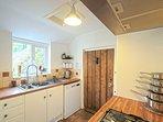 KitcheThe kitchen has top of the range appliances, family size dishwasher, fridge/freezer, washer/dr