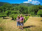 Owners in Cherry Orchard with Luberon in the Background