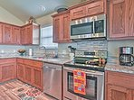 Stainless steel appliances give the kitchen a modern and sleek feel.