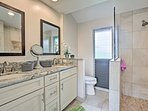 The gorgeous master bathroom has a walk-in shower.