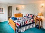 Upstairs bedroom with double bed and huge bay window overlooking the ocean. Watch sunrise from bed!
