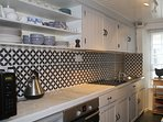 Well equipped kitchen with espresso coffee maker
