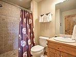 Utilize the walk-in shower found in the downstairs bathroom.