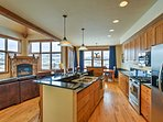 The kitchen is fully equipped with stainless steel appliances.
