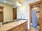 The fourth bathroom is equipped with a walk-in shower.