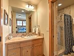 Wash up in the master bathroom's walk-in shower.