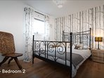 Beautiful, fresh bedroom at rear of apartment with mirrored wardrobes.