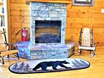 Enjoy the Stone Stacked FIREPLACE on the gorgeous Amish rocking chairs.