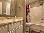 Rinse off in the shower/tub combo of this full bathroom.