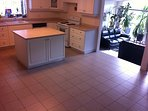 Large kitchen with porcelain tile floor
