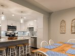 Island seating for 4 adjacent to the dining area keeps friends and families close.