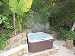 The 4 person hot tub is located in a very private and romantic setting above Mermaid Falls