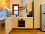 Kitchen - stove, dishwasher.