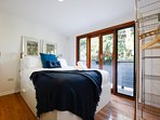 Main bedroom - luxurious queen sized bed.