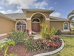 Lush landscaping and tropical flora welcome you to your Cape Coral casa.