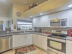 The fully equipped kitchen is outfitted with stainless steel appliances.
