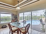Serve lunch around this etched glass dining table overlooking the canal and pool.