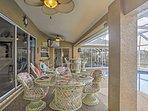 Tropical furnishings adorn the screened-in lanai.
