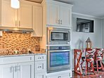 This unit boasts a 4-burner stovetop, oven, and microwave.