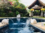 relax in a heart shaped pool with fountains