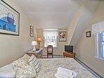 Bedroom 2: Queen bed and flat-screen tv.