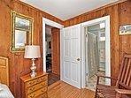 Bedroom 1: Main floor single with ensuite full bath.