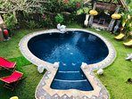 round shaped pool with sun bed lounger