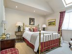 The Tartan Room (upstairs) is a cosy traditional room with King size Victorian-style brass bed.