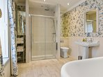 Mayfly Room large en suite bathroom with a walk-in shower with luxury double head gas power shower.