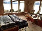 Panorama view: Sleeps 2 in the living room (Sofa turns into bed at night)