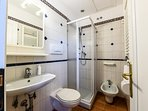 The bathroom with shower.